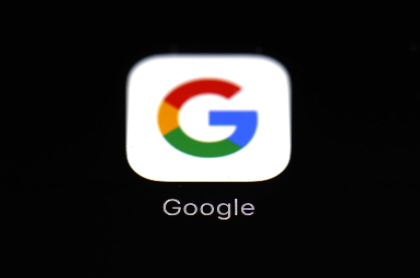 FILE - This March 19, 2018 photo shows the Google app on an iPad in Baltimore. Big Tech companies reported mixed quarterly earnings on Thursday, July 30, 2020, a day after their top executives faced a tough congressional grilling over their market power and alleged monopolistic practices. (AP Photo/Patrick Semansky, File)