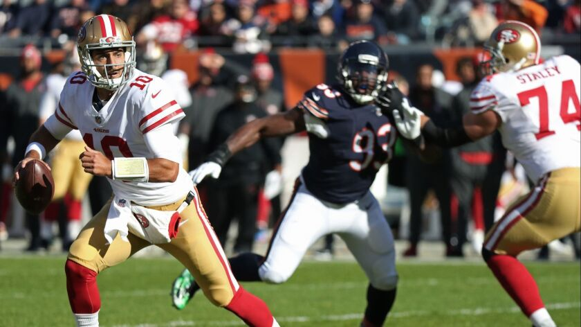 San Francisco 49ers quarterback Jimmy Garoppolo (10) scrambles in the first quarter at Soldier Field
