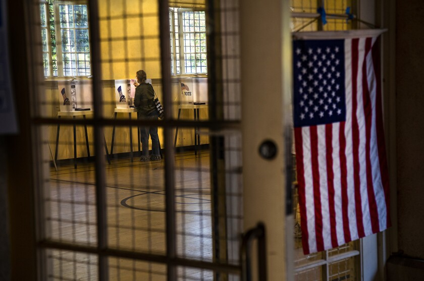 LOS ANGELES, CA - JUNE 4, 2019: A voter checks her ballot while voting at Silver Lake Recreation Ce