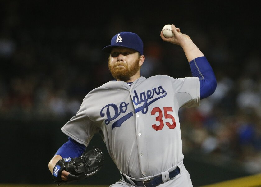 Los Angeles Dodgers' Brett Anderson throws a pitch against the Arizona Diamondbacks during the sixth inning of a baseball game Wednesday, July 1, 2015, in Phoenix. (AP Photo/Ross D. Franklin)