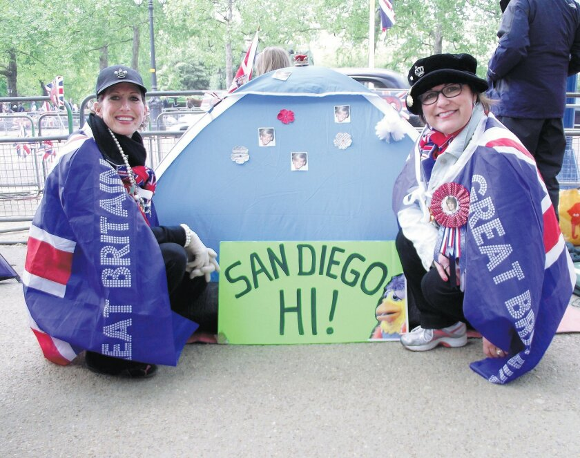 Julie (left) and Jane Hetherington of San Diego traveled to England for the royal wedding and camped out along the wedding procession route in central London.