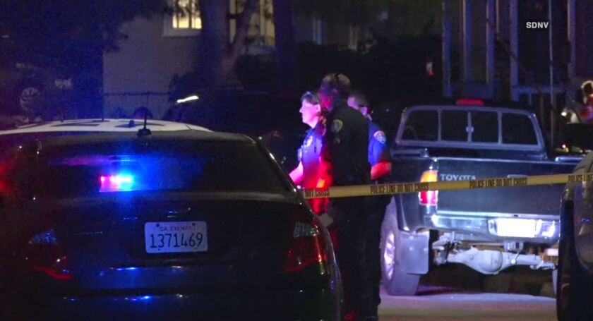 San Diego police investigate at the scene where a 16-year-old boy was fatally shot May 23 on Kelly Street in Linda Vista.