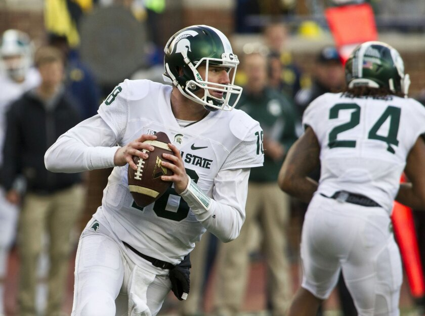 FILE - In this Oct. 17, 2015, file photo, Michigan State quarterback Connor Cook (18) looks to throw a pass during an NCAA college football game against Michigan in Ann Arbor, Mich. Michigan State coach Mark Dantonio indicated Cook might be a game-time decision against Penn State on Saturday, Nov. 28. If he can't play, backups Tyler O'Connor and Damion Terry will have to fill in like they did against Ohio State. (AP Photo/Tony Ding, File)