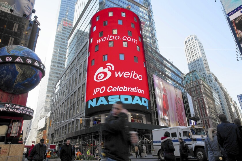 Nasdaq's surge since June spawned a rise in tech IPOs, including that of Chinese microblogging site Weibo on April 17. Above, the company's logo is displayed on a monitor outside Nasdaq in New York.