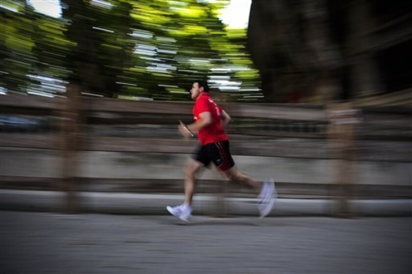 Juan Pedro Lecuana, 38 of Spain trains on the route where he will be running in front of the bulls during the bulls runs at the San Fermin Festival, in Pamplona northern Spain, Thursday June 30, 2011. Juan Pedro rhas taken part in the running of the bulls during the last 23 years. (AP Photo / Alvaro Barrientos)