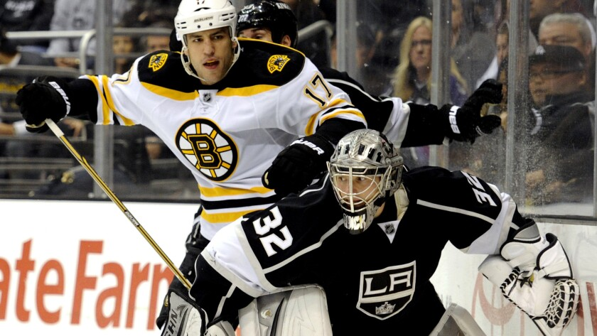 Kings goalie Jonathan Quick (32) keeps Milan Lucic (17) away from the puck during a game against the Bruins. Quick and Lucic will now be teammates after a trade with Boston on Friday.