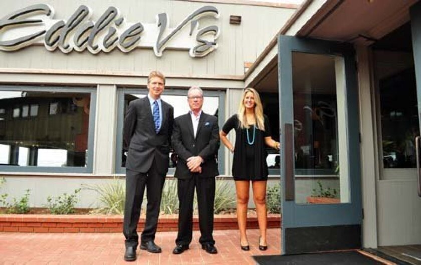 General Manager, Ron Fabor with President and CEO, Jim VanDercook and Hostess Sierra Richter welcome guests to the grand opening of Eddie V's on Aug. 22. Photo: Greg Wiest.