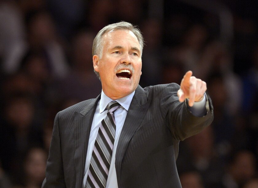 FILE - In this Feb. 28, 2014, file photo, Los Angeles Lakers head coach Mike D'Antoni gestures during the second half of an NBA basketball game against the Sacramento Kings in Los Angeles. Lakers spokesman John Black confirmed D'Antoni's resignation Wednesday, April 30. (AP Photo/Mark J. Terrill, F