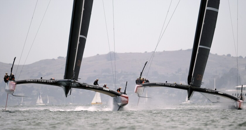 Oracle Team USA practices with both of its AC72 catamarans before the Louis Vuitton Cup Finals in August. The AC72s are built for speed and power.