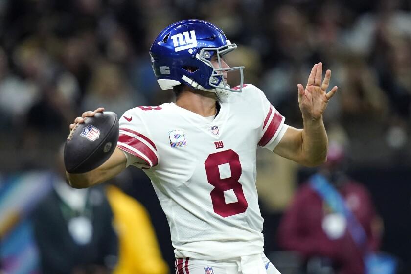 New York Giants quarterback Daniel Jones (8) passes in the second half of an NFL football game against the New Orleans Saints in New Orleans, Sunday, Oct. 3, 2021. (AP Photo/Brett Duke)