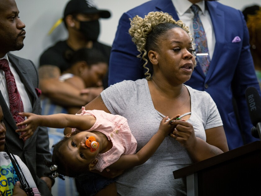 Tomika Miller, the widow of Rayshard Brooks, speaks at a news conference on Monday, June 15, 2020, in Atlanta. The Brooks family and their attorneys spoke to the press just days after Rayshard Brooks was shot and killed by police at a Wendy's restaurant parking lot in Atlanta. The family wants the officers involved in Brooks' death arrested and prosecuted. (AP Photo/Ron Harris)