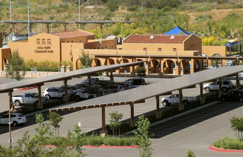 Solar panels shade the parking lot at Carlsbad's Alga Norte Community Park. Photo by Charlie Neuman/UT San Diego/Copyright 2015 San Diego Union-Tribune, LLC