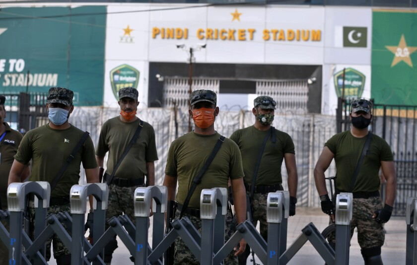 Pakistan paramilitary troops stand guard outside the Pindi Cricket Stadium following canceling of 1st one day international cricket match between Pakistan and New Zealand, in Rawalpindi, Pakistan, Friday, Sept. 17, 2021. New Zealand abandoned its cricket tour of Pakistan over security concerns that mystified the hosts, just before the Black Caps' first scheduled match in Pakistan in 18 years. (AP Photo/Anjum Naveed)