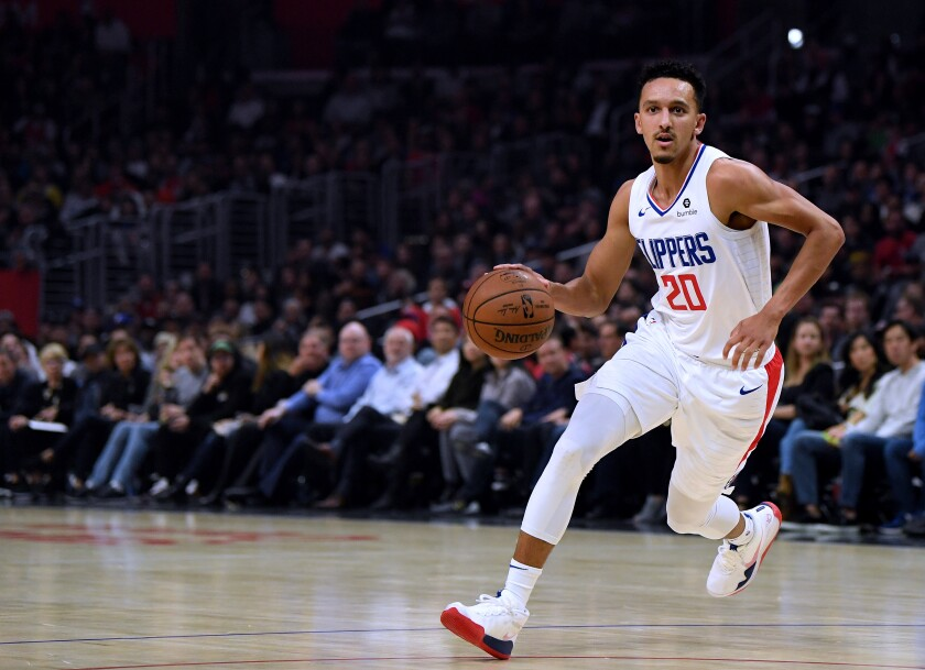 Clippers guard Landry Shamet works with the ball during a game against the Raptors on Nov. 11 at Staples Center.