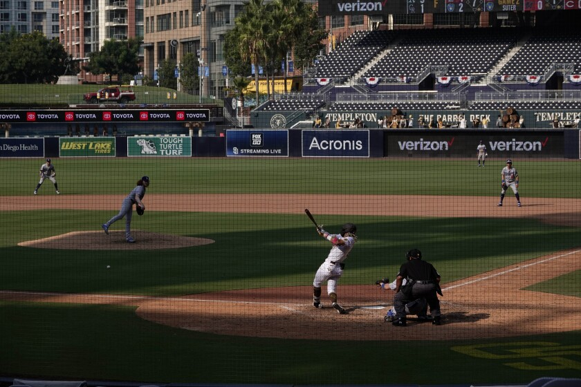 Fernando Tatis Jr. bats against Dodgers pitcher Dustin May on Wednesday at Petco Park.
