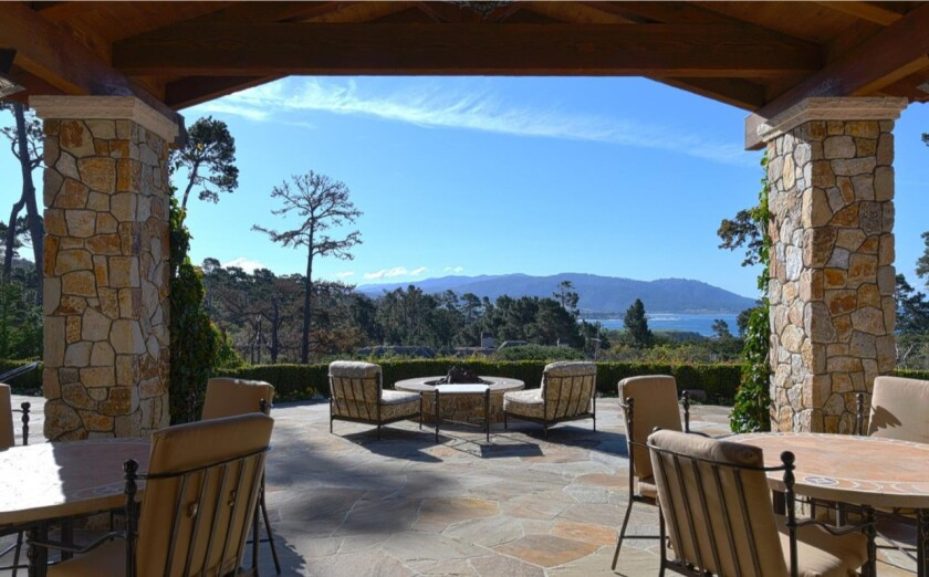 The 1.25-acre estate in Pebble Beach looks out toward the Pebble Beach Golf Links, the ocean and the mountains.