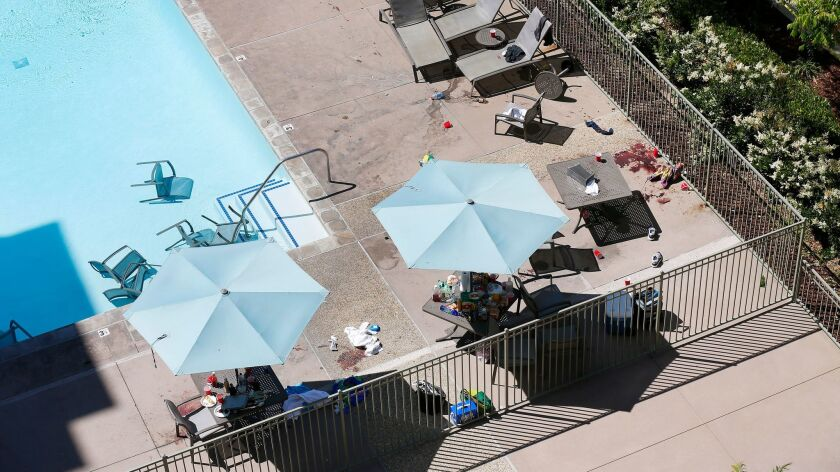 SAN DIEGO, CA - MAY 1, 2017 - Remnants of a birthday party in the pool area at the La Jolla Crossroa