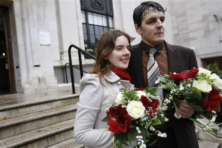 Tom Freeman and Katherine Doyle, a heterosexual couple, outside Islington Register Office, in London after failing to get a civil partnership Tuesday, Nov. 9, 2010. Tom Freeman and Katherine Doyle are in love and want to tie the knot, but they don't want to get married. The 26-year-old Londoners think they should be allowed to have a civil partnership, a form of legal union available in Britain only to same-sex couples. Gay rights activists are backing the couple's bid in an attempt to legalize gay marriage. (AP Photo/Alastair Grant)