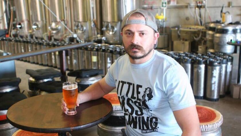 Joe Lisica, brewmaster at Little Miss Brewing enjoys a Helldiver IPA. (Liz Bowen)