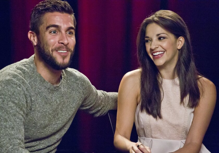 """In this Oct. 15, 2015 photo, actors Josh Segarra, left, and Ana Villafane, of the Broadway bio-musical """"On Your Feet!,"""" appear during an interview in New York. Segarra and Villafane star as Cuban-American power couple Gloria and Emilio Estefan, opening Thursday, Nov. 5.  (AP Photo/Bebeto Matthews)"""