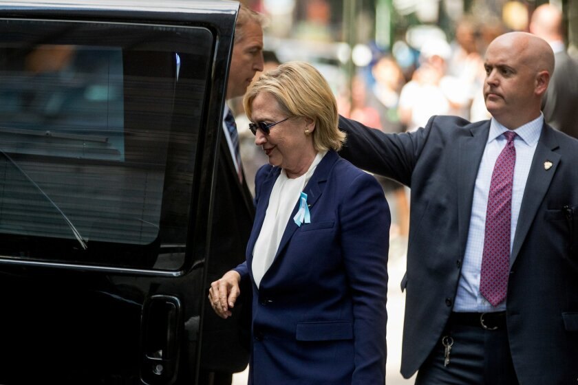 """Democratic presidential candidate Hillary Clinton gets into a van as she leaves an apartment building Sunday, Sept. 11, 2016, in New York. Clinton's campaign said the Democratic presidential nominee left the 9/11 anniversary ceremony in New York early after feeling """"overheated."""" (AP Photo/Andrew Ha"""