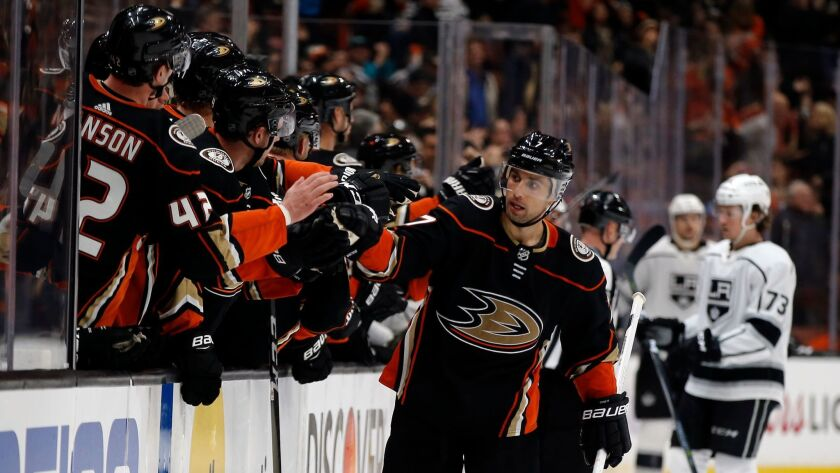 Ducks left wing Andrew Cogliano, back after missing the first games of his career to a two-game suspension, celebrates with teammates after the Ducks scored during the third period against the Kings.