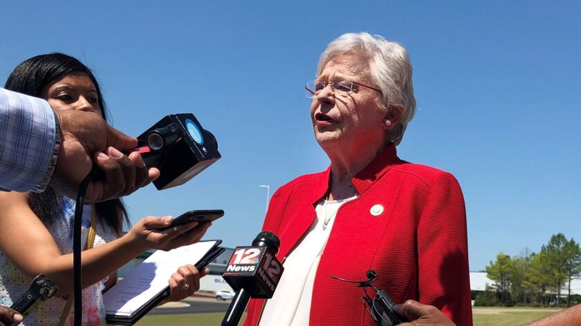Alabama Gov. Kay Ivey discusses a bill that would virtually outlaw abortion in the state while visit