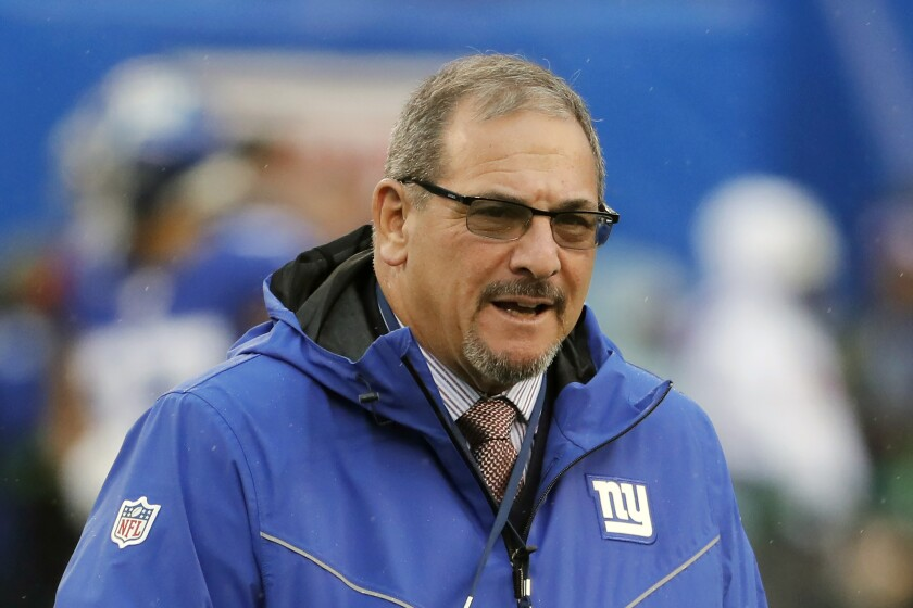 FILE - New York Giants general manager Dave Gettleman watches warm ups before an NFL football game against the Philadelphia Eagles in East Rutherford, N.J., in this Sunday, Dec. 29, 2019, file photo. While sick of the losing seasons, co-owner John Mara felt the New York Giants established a foundation and culture under rookie coach Joe Judge, giving him optimism the playoffs may not be far away. Mara also disclosed Wednesday, Jan. 6, 2021, 69-year-old Dave Gettleman would be back for a fourth season. (AP Photo/Seth Wenig, File)