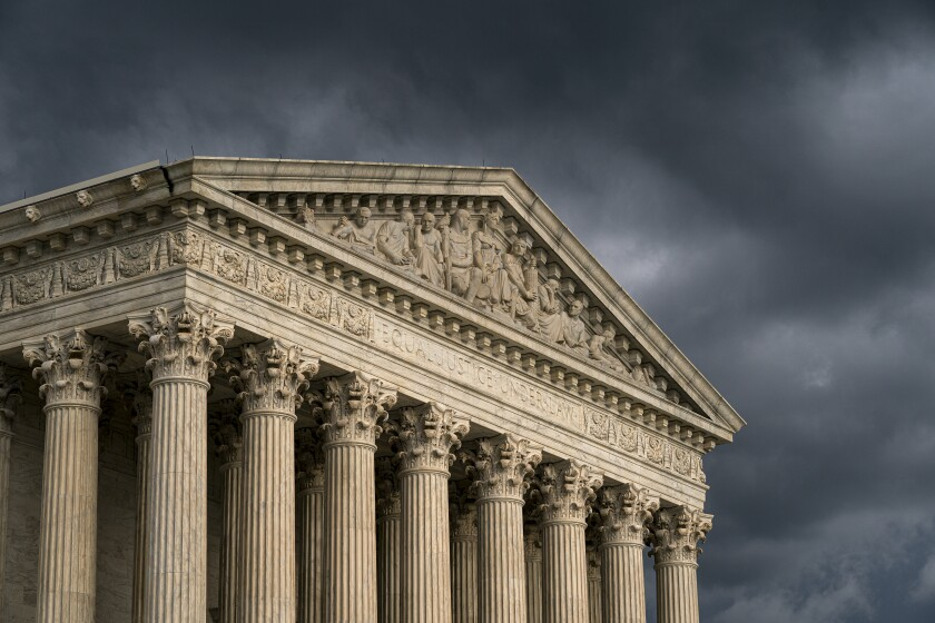 FILE - In this June 20, 2019, file photo, the Supreme Court is seen in Washington as a storm rolls in. On one side of an upcoming Supreme Court case over a proposed natural gas pipeline in New Jersey are two lawyers with more than 250 arguments between them. On the other is Jeremy Feigenbaum, a lawyer for New Jersey who will be making his first Supreme Court appearance.(AP Photo/J. Scott Applewhite, File)