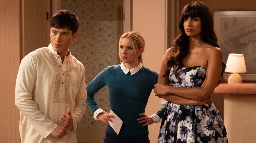 """Manny Jacinto, Kristen Bell, center, and Jameela Jamil in """"The Good Life"""" on NBC."""