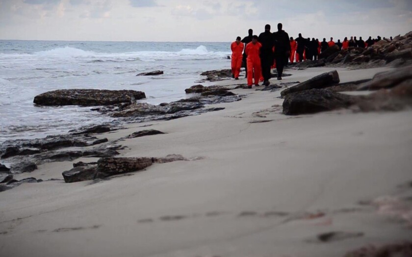 An image from a video released Feb. 15 shows Islamic militants leading Egyptian Christian hostages along a beach before they are allegedly beheaded in the Libyan capital of Tripoli.