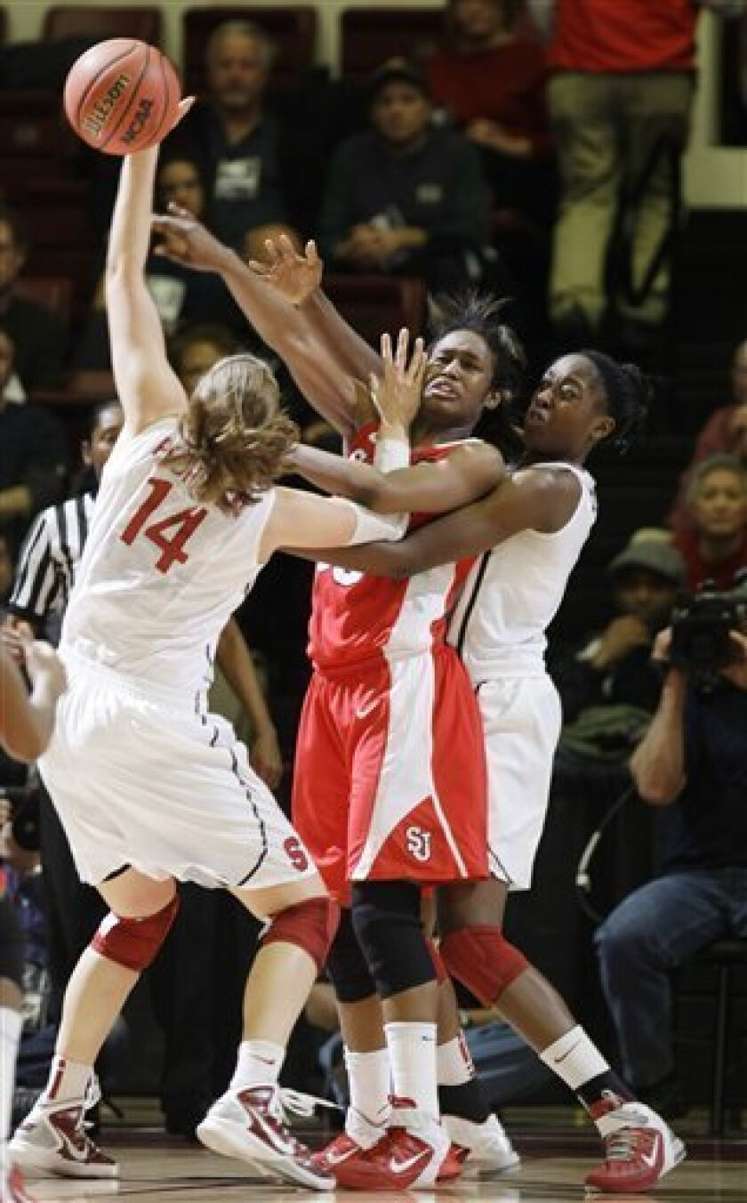 Stanford forward Kayla Pedersen (14) defends as St. John's forward Centhya Hart, center, passes, as Stanford forward Chiney Ogwumike, right, helps defend during the first half of a second-round NCAA women's college basketball tournament game in Stanford, Calif., Monday, March 21, 2011. (AP Photo/Paul Sakuma)