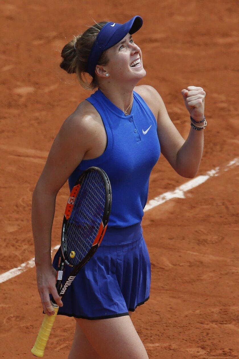 Ukraine's Elina Svitolina celebrates winning her third round match of the French Open tennis tournament against Serbia's Ana Ivanovic at the Roland Garros stadium in Paris, France, Saturday, May 28, 2016. (AP Photo/Michel Euler)
