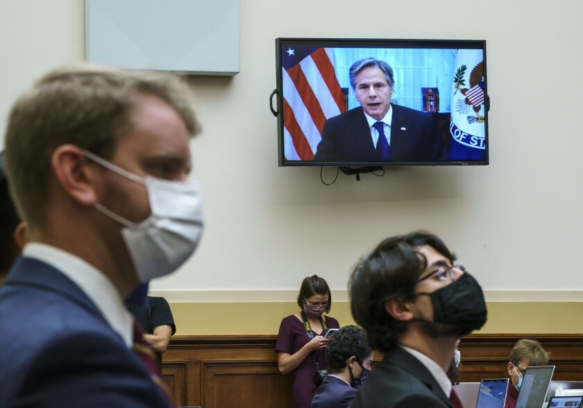 Secretary of State Antony Blinken appears remotely on a TV monitor before the House Foreign Affairs Committee.