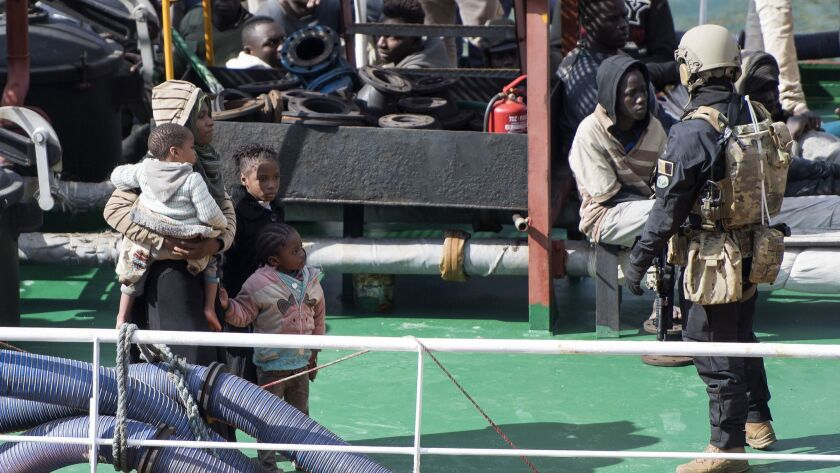 Armed forces stand onboard the Turkish oil tanker El Hiblu 1, which was hijacked by migrants, in Val