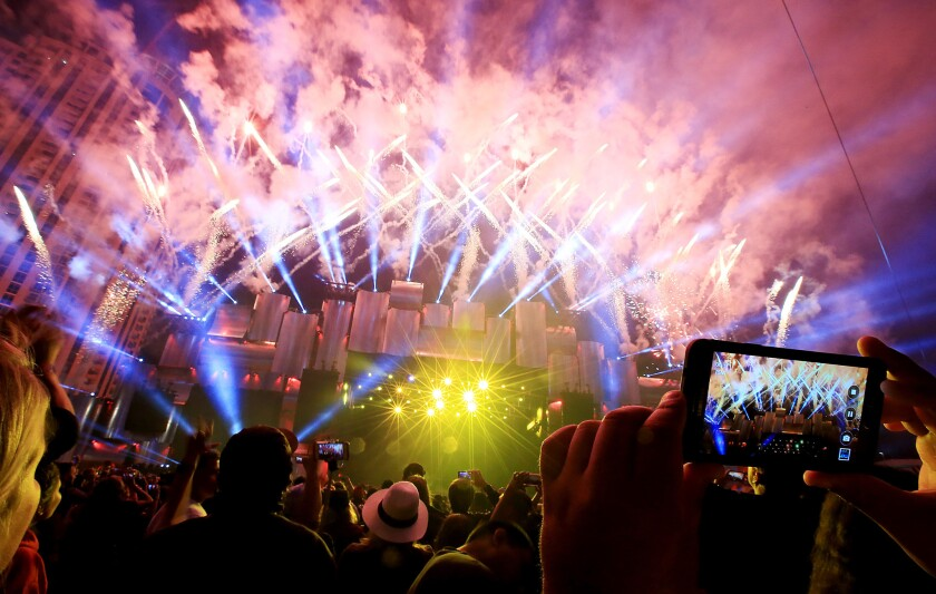 Music fans take in a late-night fireworks show at 2015's Rock in Rio USA at the Las Vegas Festival Grounds.