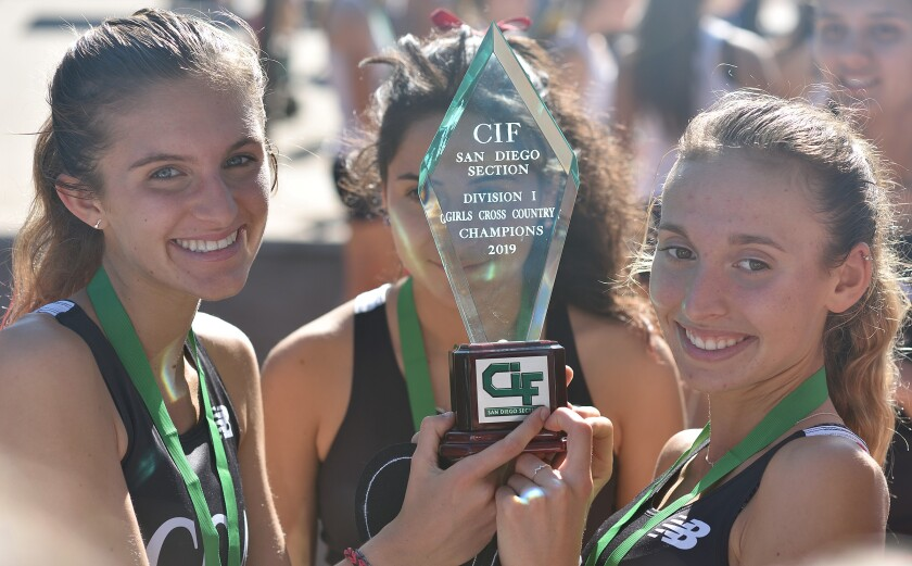 Carlie Dorostkar (l), Elizabeth Emberger (r) and Allison Rios (center) were CCA's top individual finishers Saturday.