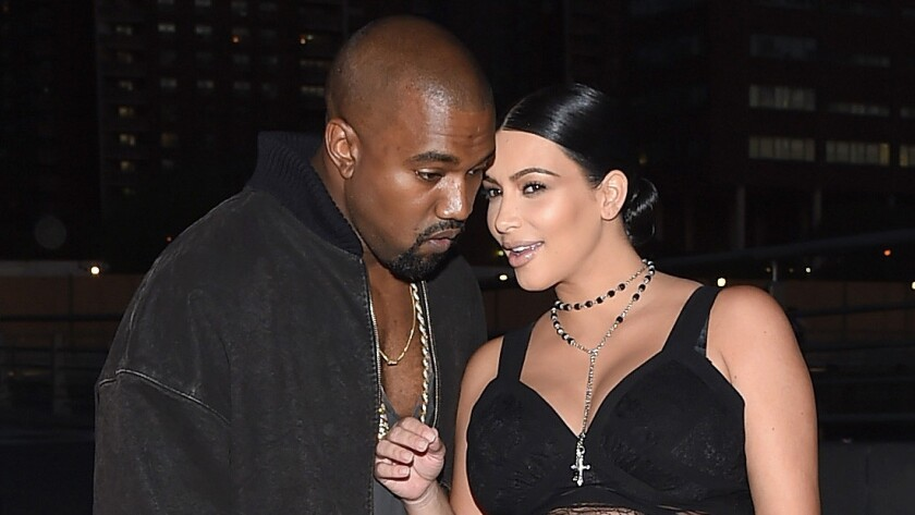 Kim Kardashian West, right, and husband Kanye West, left, paid $6.3 million for the roughly two-acre parcel in the Madison Club, a resort-style community in La Quinta.