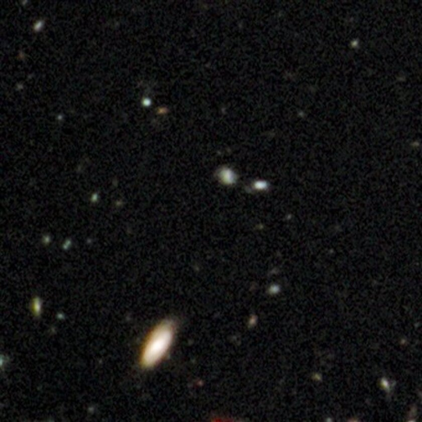 This undated handout photo provided by NASA, taken by the Hubble Space Telescope, shows a snapshot of when the universe was just a toddler, 600 million years after the Big Bang, the earliest image yet. (AP Photo/NASA)