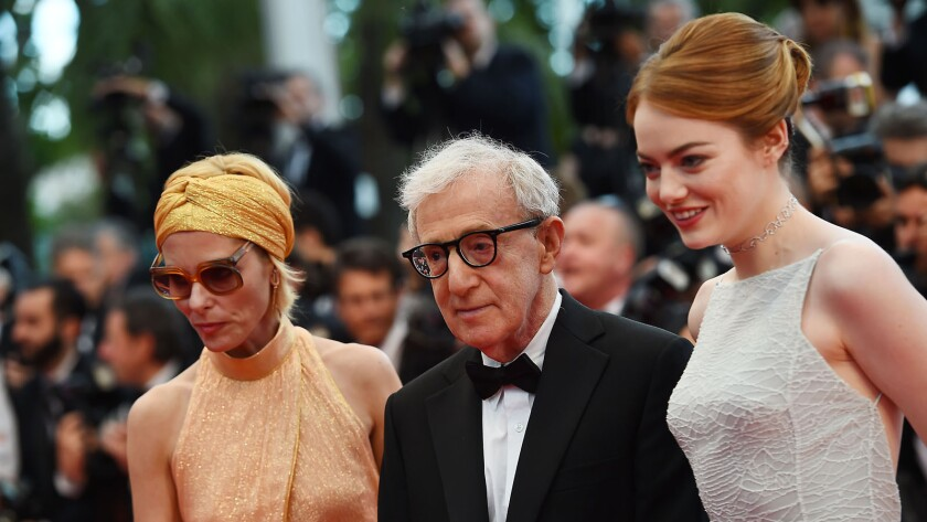 "Woody Allen, center, poses with actresses Parker Posey, left, and Emma Stone as they arrive for the screening of the film ""Irrational Man"" at the Cannes Film Festival."