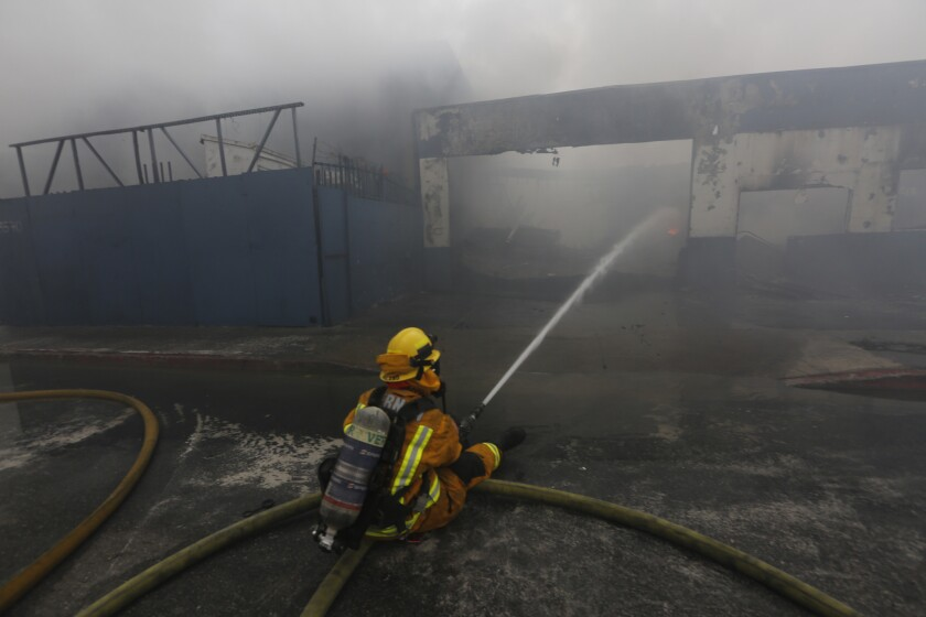 Cleanup begins at Maywood fire site