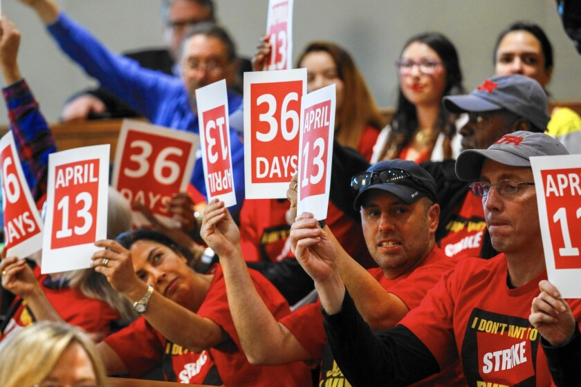 Supporters and members of the California Faculty Assn. attend a meeting of Cal State trustees in Long Beach on March 8.