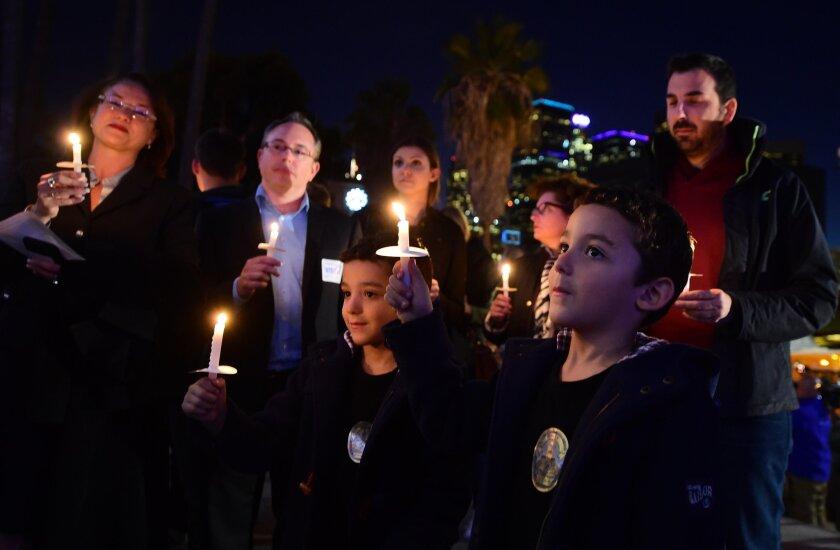 Hundreds attend vigil for Paris victims at L.A. City Hall