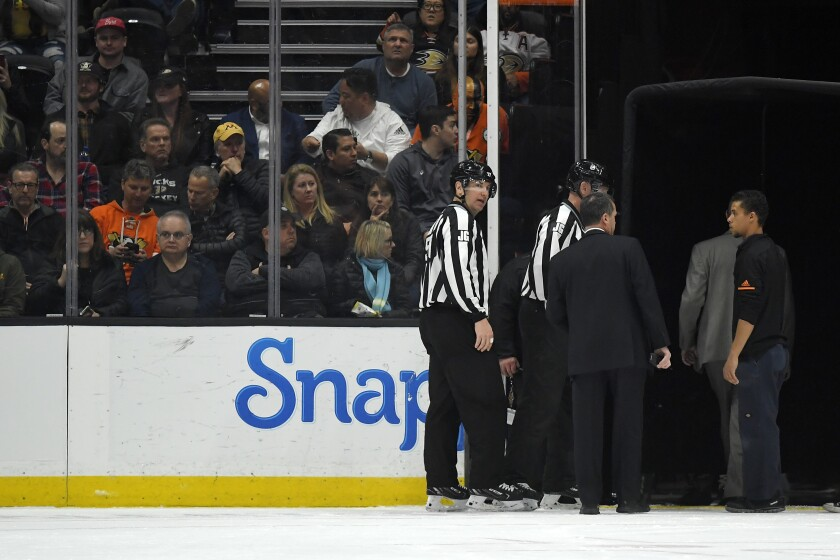 Officials leave the ice after the game between the Anaheim Ducks and the St. Louis Blues was postponed during the first period because of a medical emergency involving Blues defenseman Jay Bouwmeester.