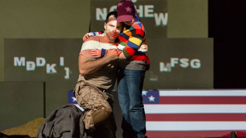 """Baritone David Adam Moore is the Soldier and actor Ryan Singer is the Child in San Diego Opera's """"Soldier Songs,"""" playing through Nov. 13 at Balboa Theatre."""