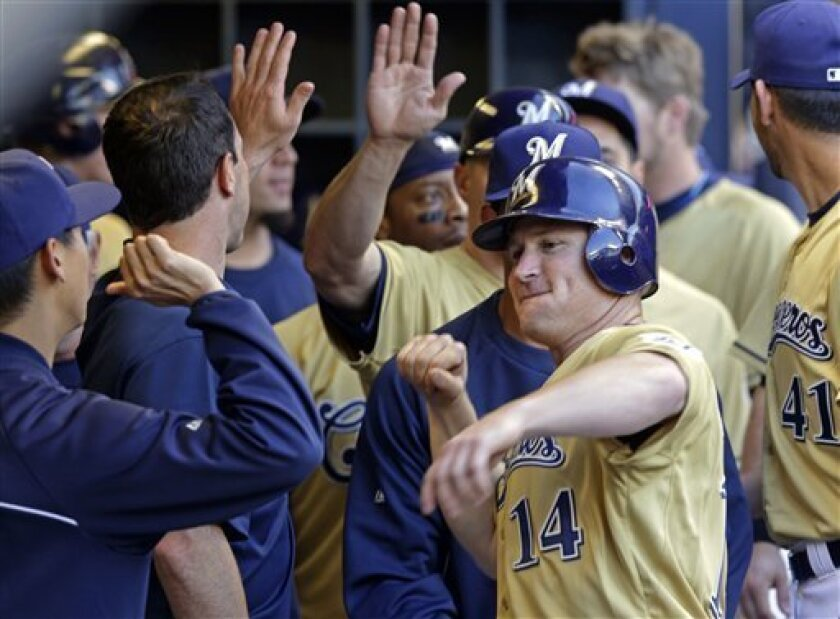 Milwaukee Brewers' Brooks Conrad celebrates with teammates after hitting a two-run home run during the fourth inning of a baseball game against the Pittsburgh Pirates on Saturday, June 2, 2012, in Milwaukee. (AP Photo/Morry Gash)