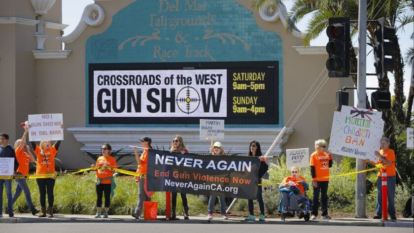 Supporters of NeverAgainCa in March protested against the Crossroads of the West Gun Show outside the Del Mar Fairgrounds, where the show was being held.