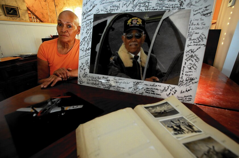Shelia McGee shows memorabilia belonging to her father, Clarence Huntley, a member of the Tuskegee Airmen.