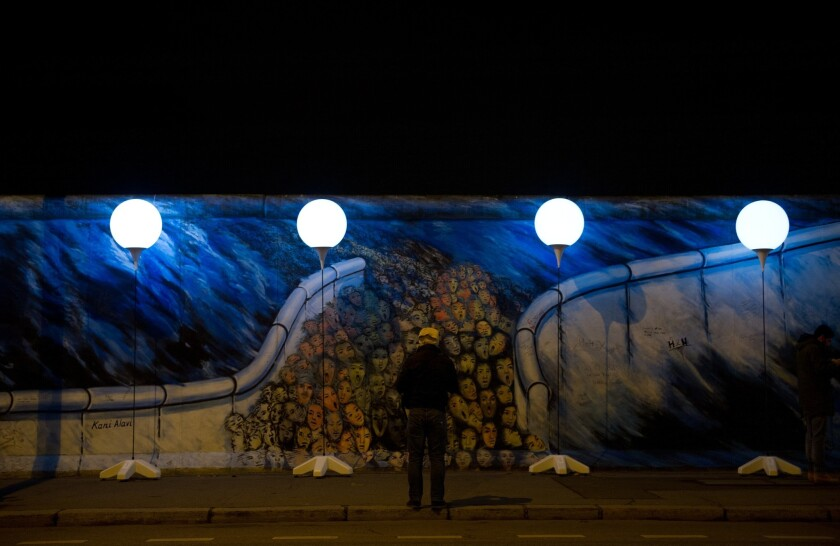 Lighted balloons trace the former path of the Berlin Wall, a public art installation to mark the 25th anniversary of the demise of the Cold War barrier. On Sunday's anniversary, the 8,000 balloons will be released.