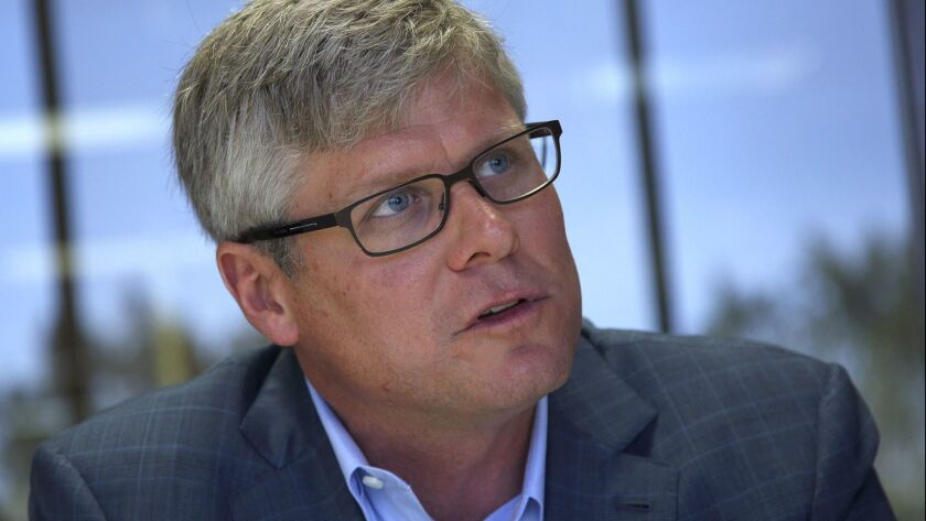 Qualcomm CEO Steve Mollenkopf aims to deliver on a growth strategy to boost the company's lagging share price.